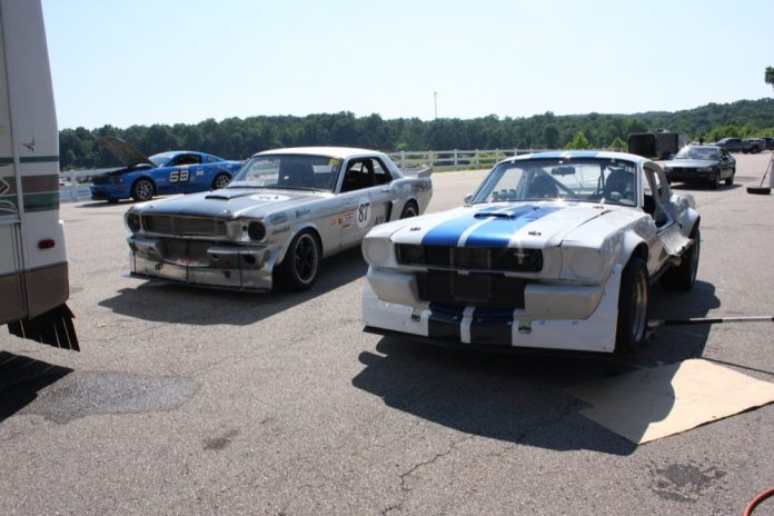 Keith Campbell races his fastback 1965 Mustang in Outlaw Vintage Racing class in NASA Southeast with his son Kyle, who campaigns a 1966 coupe.