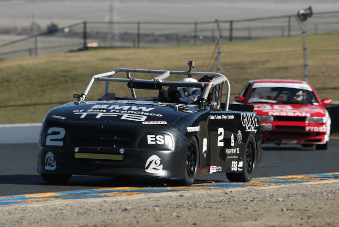 The black number 2, special bodied and lightened, E30 BMW of Ethan Stone took first in ESR.