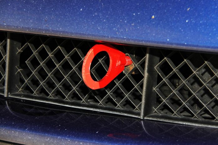 This fixed, large-eyelet tow hook is an easy to access, fixed point for any emergency crews to use to get your car off the track. The downside is it will be the first thing that runs into the back of a competitor in a minor contact or bump-draft situation.