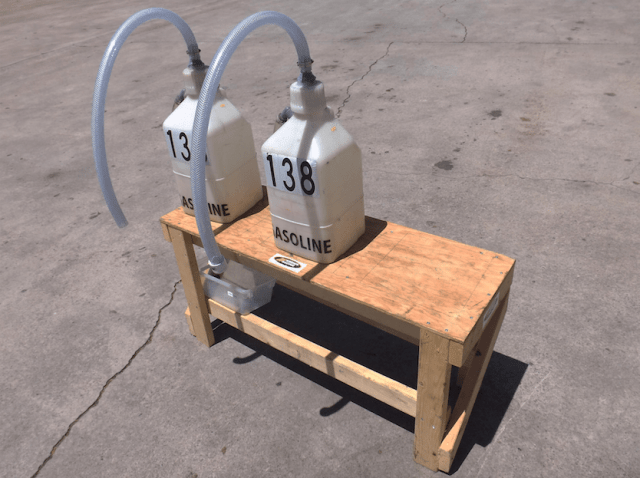 The fuel table was designed to hold two fuel jugs and be stable enough that the ten gallons of combustible fuel are safely elevated to 24 inches in height. It was important to build the table solidly as each 5 gallon fuel can filled with gas will weigh approximately 34 pounds.