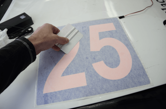 """By using reverse cut numbers, you cover most of the pink with whatever color vinyl you choose. This is as close to """"Mazda blue"""" as I could find. Apply decals with a sprayer filled with water and a couple of drops of baby shampoo, which lets the decal stick better than Windex, then squeegee out the air and liquid."""
