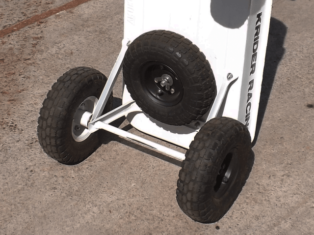 The problem with pneumatic tires is they are filled with air, which means they like to go flat. We fixed that problem with a spare tire mounted to the bottom of the pit cart.