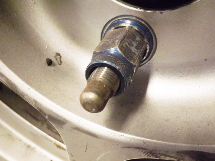 For racing applications, you want an open-ended lug nut and a long stud with a bullnose end. You want to see a portion of the stud and threads come through the lug nut once it is torqued.
