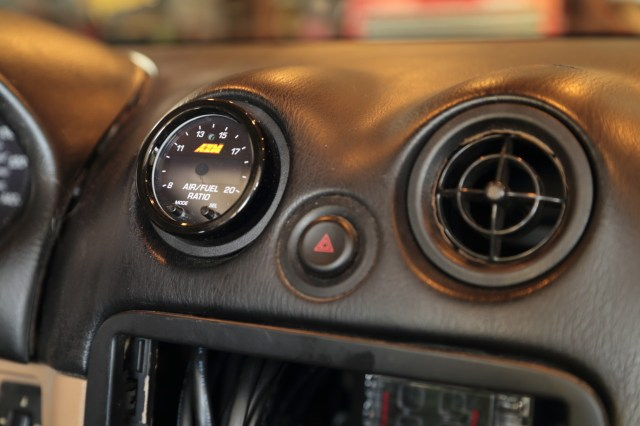Conveniently, 2 1/16 gauges slip neatly into the air conditioning outlets on Miatas, providing a great spot for the driver to check the gauge quickly on straightaways.