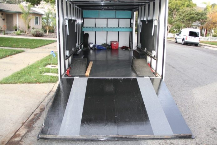 There wasn't enough mat left over to cover the ramp door, so I painted it with Rust Oleum marine-grade deck paint and added some nonskid tape at the wheel tracks.
