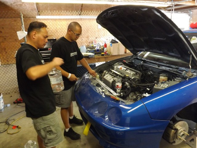 Anthony Samonte and Enrico Cruz work nonstop trying to get the Acura Integra ready for the NASA Honda Challenge Championship race on Saturday.