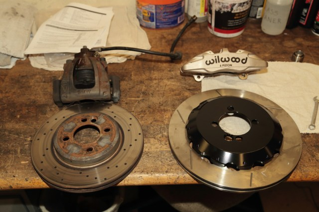 Here you can see the difference between stock and the Wilwood six-piston caliper upgrade. Even drilled stock rotors couldn't keep the brakes from fading when driven on a racetrack.