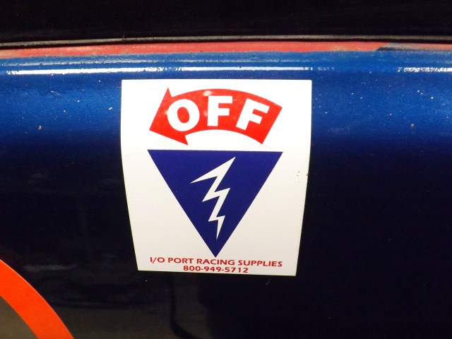 Not only are you required to have a master cut-off switch, you are required to label where that switch is for emergency personnel. You can cut your own version of it from vinyl or just press the easy button and order one from I/O Port Racing Supplies for $1.