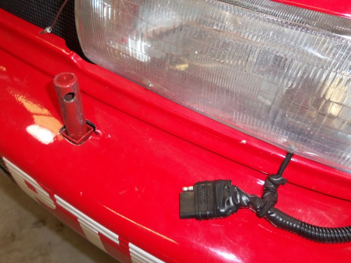 You can see the trailer wire plug setup and the two rods sticking up through the bumper for the square stock of the light bar to slide down. The hole at the top of the rod is where the removable pin is placed for quick installation or removal.