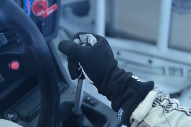 When downshifting, keep your hand in one position: palm on the right side of the shifter with fingers wrapped around the front, thumb on the left side.