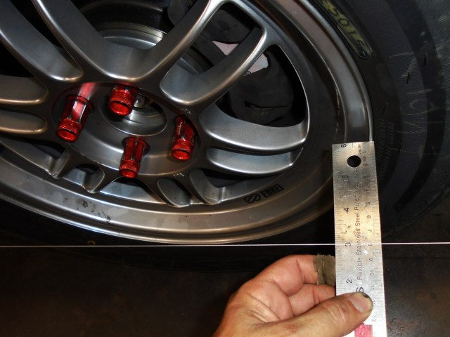 To find toe, measure the leading edge of the rim and compare that measurement to that of the trailing edge of the rim. Before making any toe adjustments, remember to straighten the steering wheel! We do our measurements in millimeters because everybody knows fractions are hard.