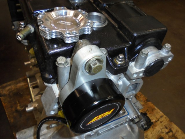 This AEM engine position module replaces the stock Honda distributor. A secondary benefit of this system is less rotating mass than the stock distributor, making the engine more efficient.