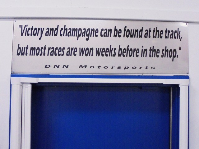 Hanging over the door at the shop is a little reminder for everyone as we tinker on our cars before a race weekend.