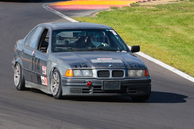 Michael Neuman beat a field of Mazda Miatas to take the TTE Championship in his BMW 318i.