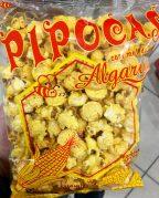 Popcorn mit Honig-Geschmack und Bienenmotiv in transparenter Folie: Pipocas. Gesehen 2016 in Portugal.