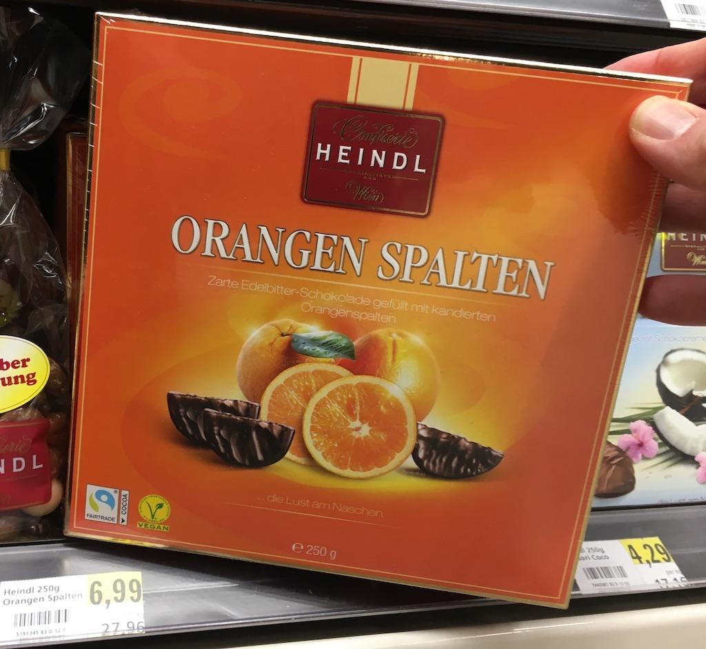Heindl Orangen Spalten Zarte Edelbitter-Schokolade gefüllt mit kandierten Orangenslaten 250 Gramm