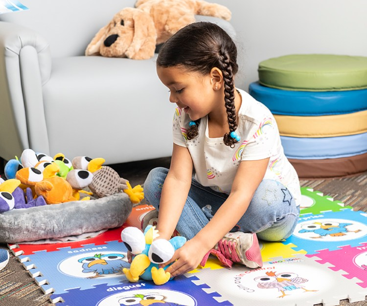 Adding comforting elements to a calming corner, like a plush companion, can help children identify emotions.