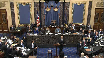 In this image from video, Alan Dershowitz, an attorney for President Donald Trump, walks from the podium after speaks during Trump's impeachment trial in the Senate at the Capitol in Washington, Jan. 27, 2020.