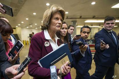 Sen. Lisa Murkowski, R-Alaska., talks to reporters as she leaves the Capitol in Washington, Tuesday, Jan. 28, 2020. (AP Photo…