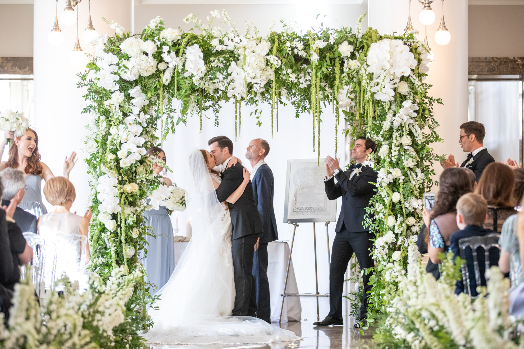 Floral ceremony arch: Floral Filled Luxurious Wedding by LMA Designs featured on Nashville Bride Guide