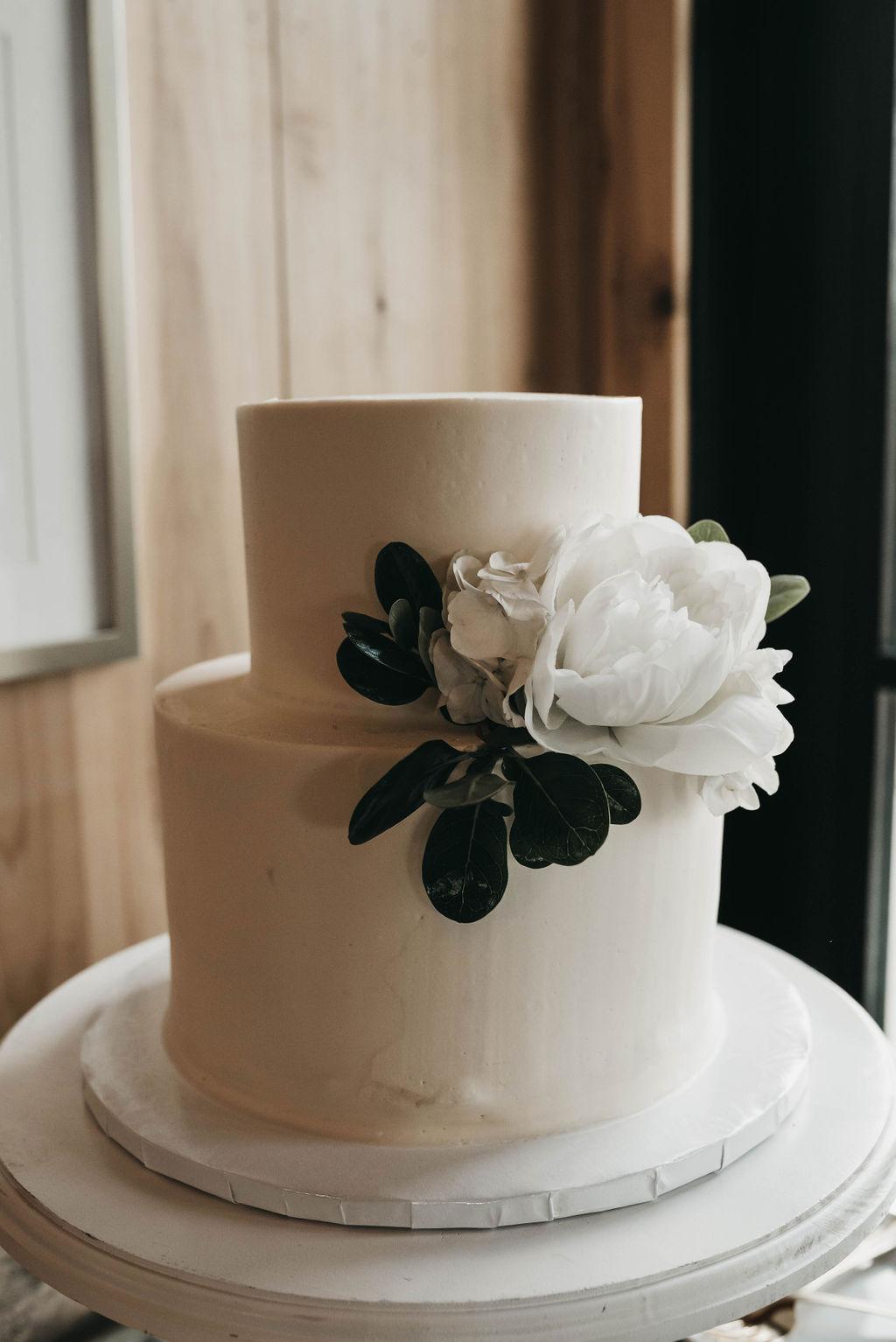 simple wedding cake design with greenery