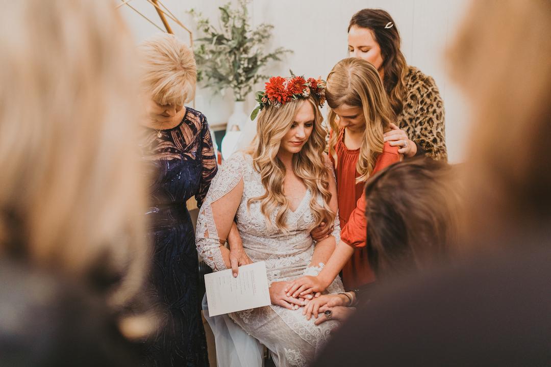 Bride praying before wedding ceremony