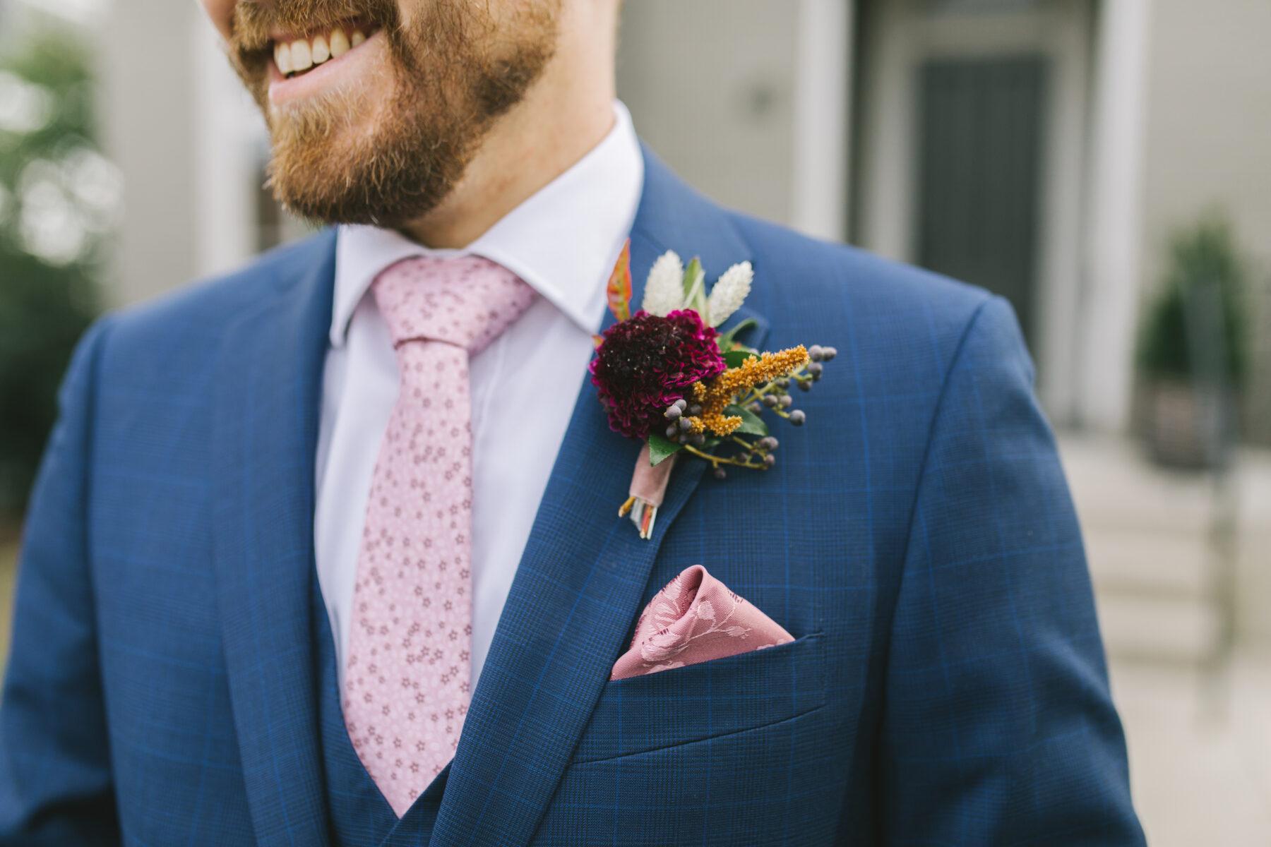 Pink pocket square and burgundy boutonniere   Nashville Bride Guide