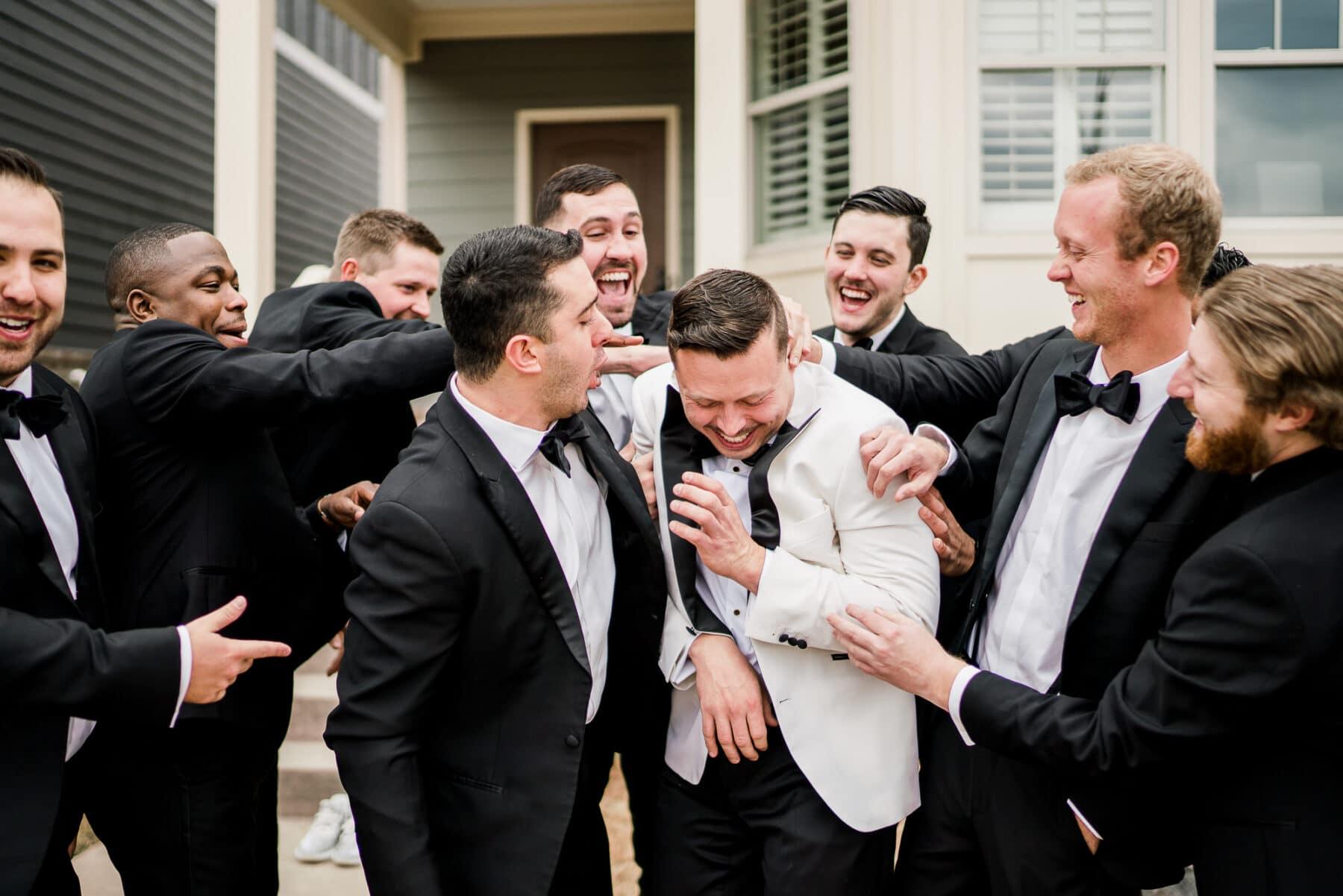 Groomsmen and Groom laughing   Nashville Bride Guide