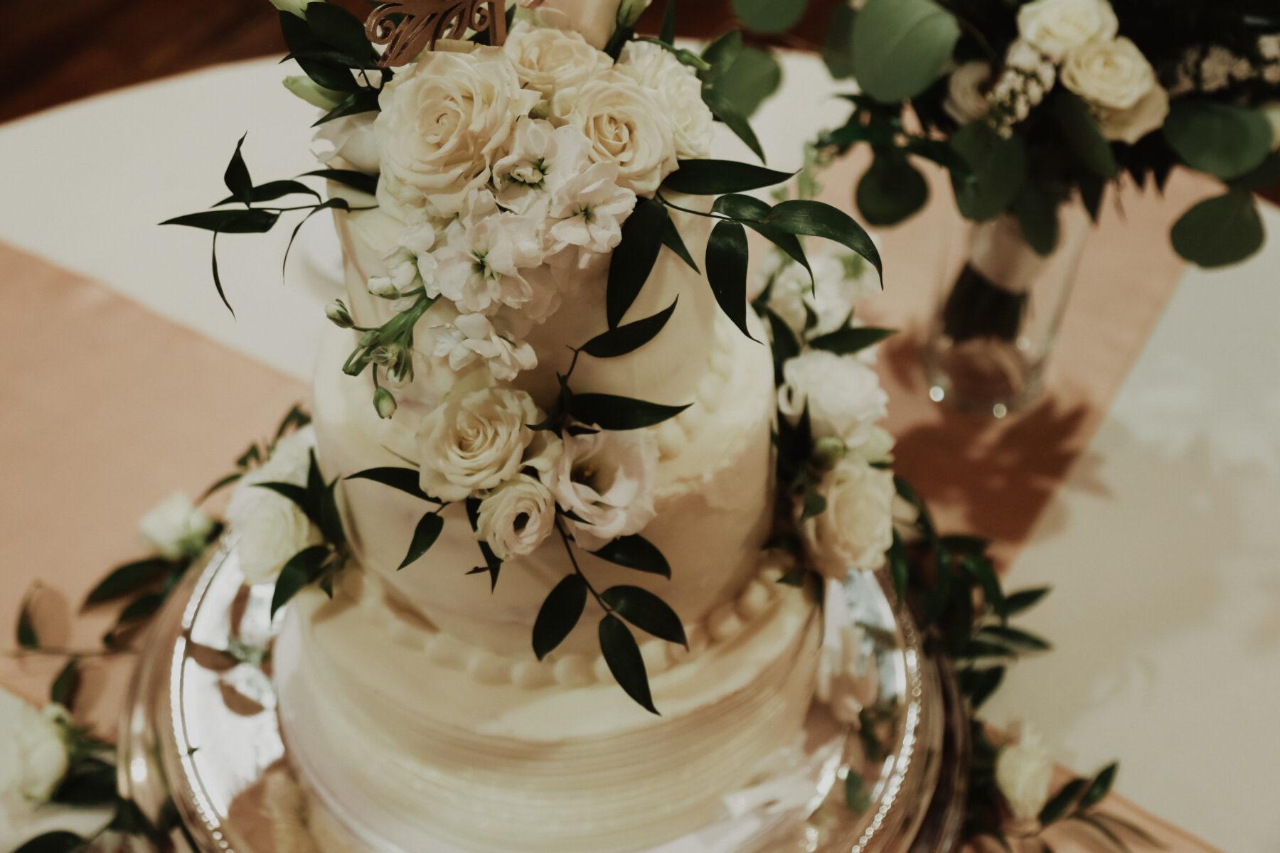 White wedding cake with greenery | Nashville Bride Guide