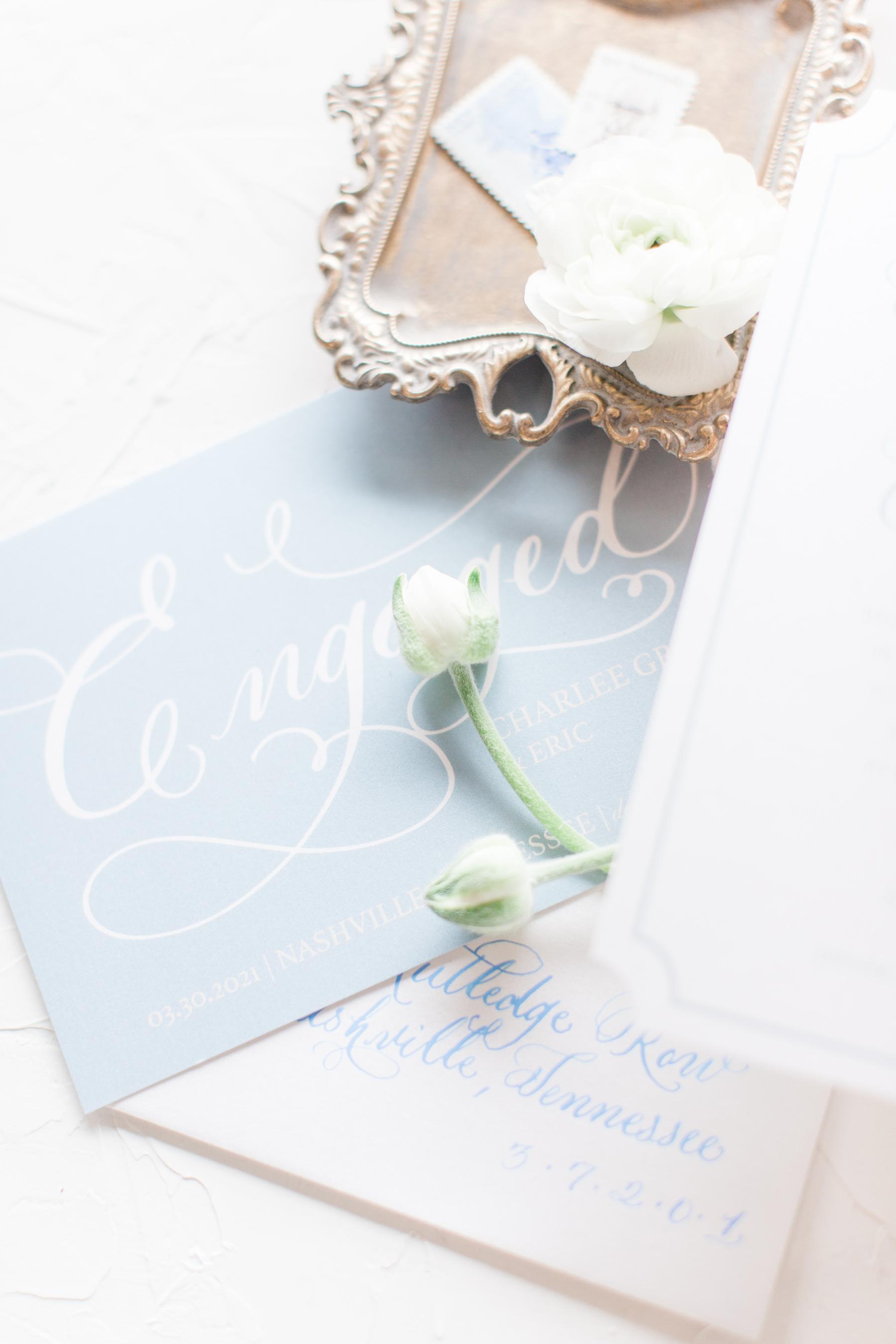 White and blue wedding invitation design