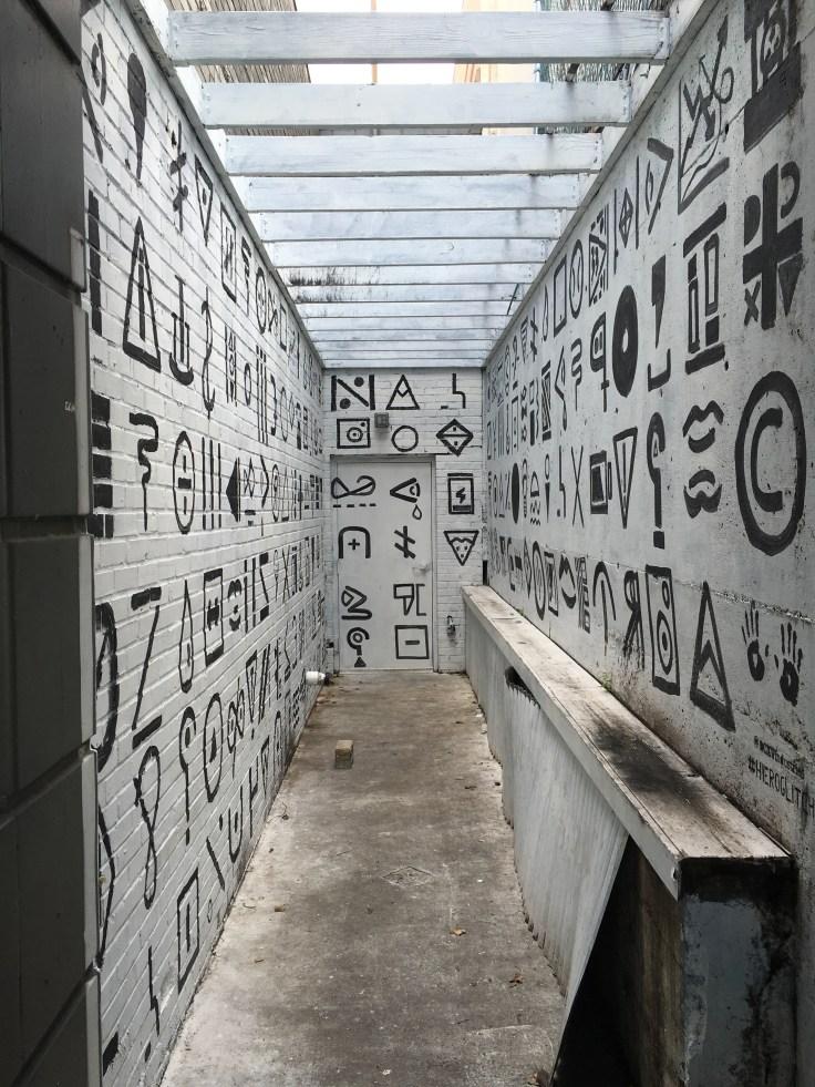 Black and white hieroglyphics mural street art Nashville