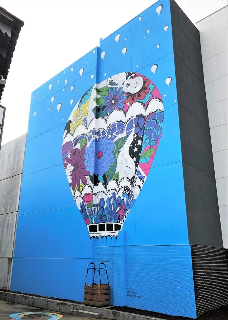 Street art mural of balloon with basket East Nashville