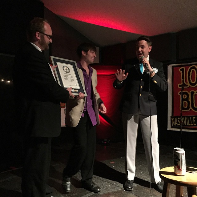 Official GUINNESS WORLD RECORDS™ adjudicatorMichael Empric presents the framed certificate to Chad Riden (left) and DJ Buckley (center).