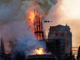 Notre Dame Cathedral spire collapsing. Photograph: Geoffroy van der Hasselt/AFP/Getty Images