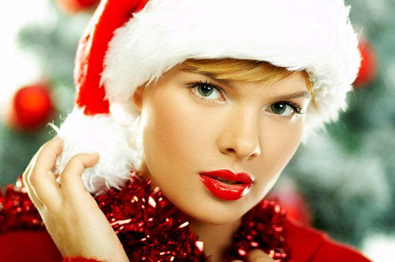 Beautiful young woman wearing santas