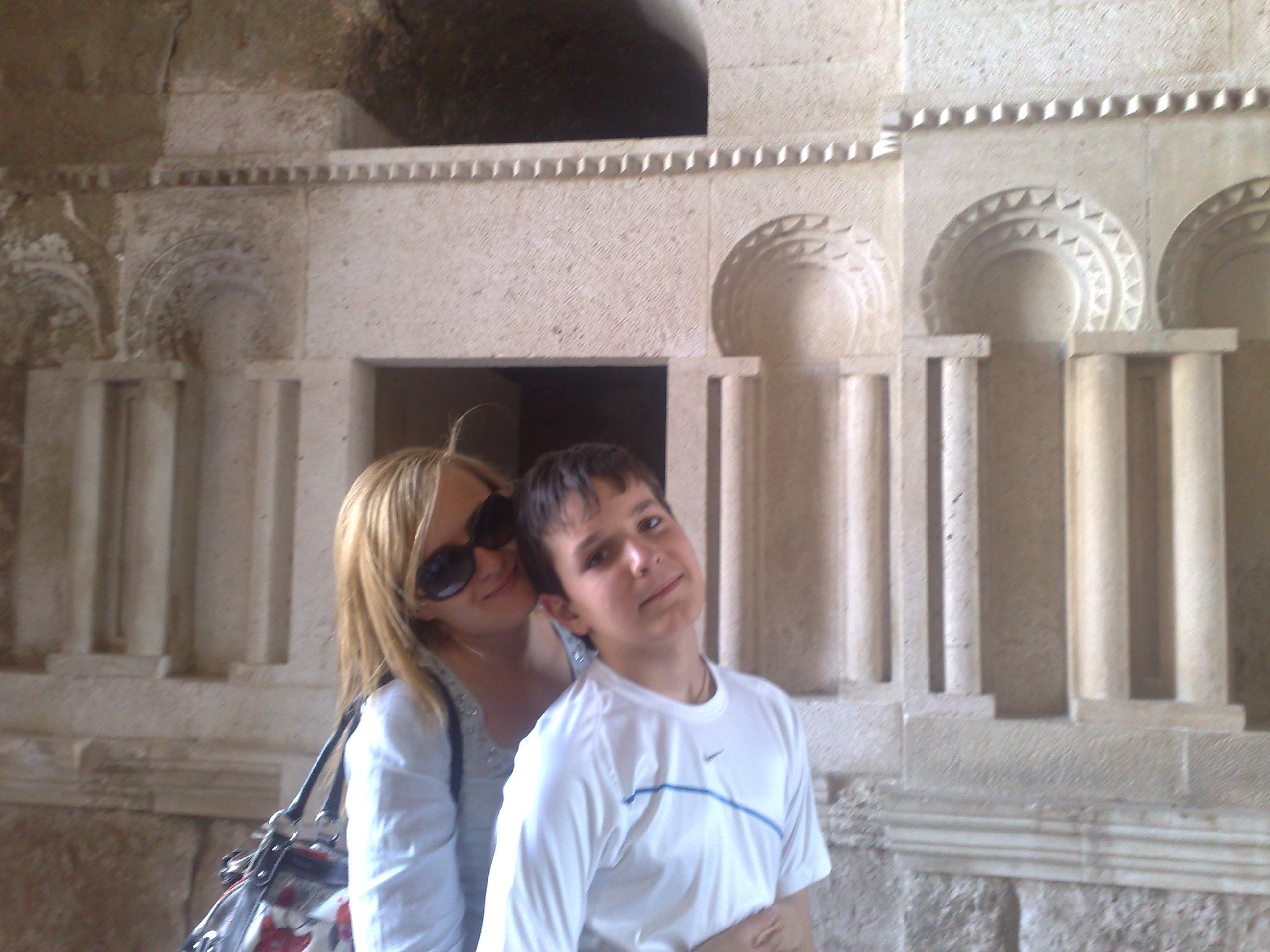 Cooling off in Amman's Citadel with big sister. Why is a piece of big sister's hair standing at an almost 90 degree ange to her head? God only knows.