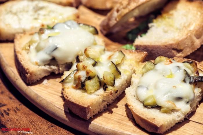 an assortedBruschetta plate withmelted cheese