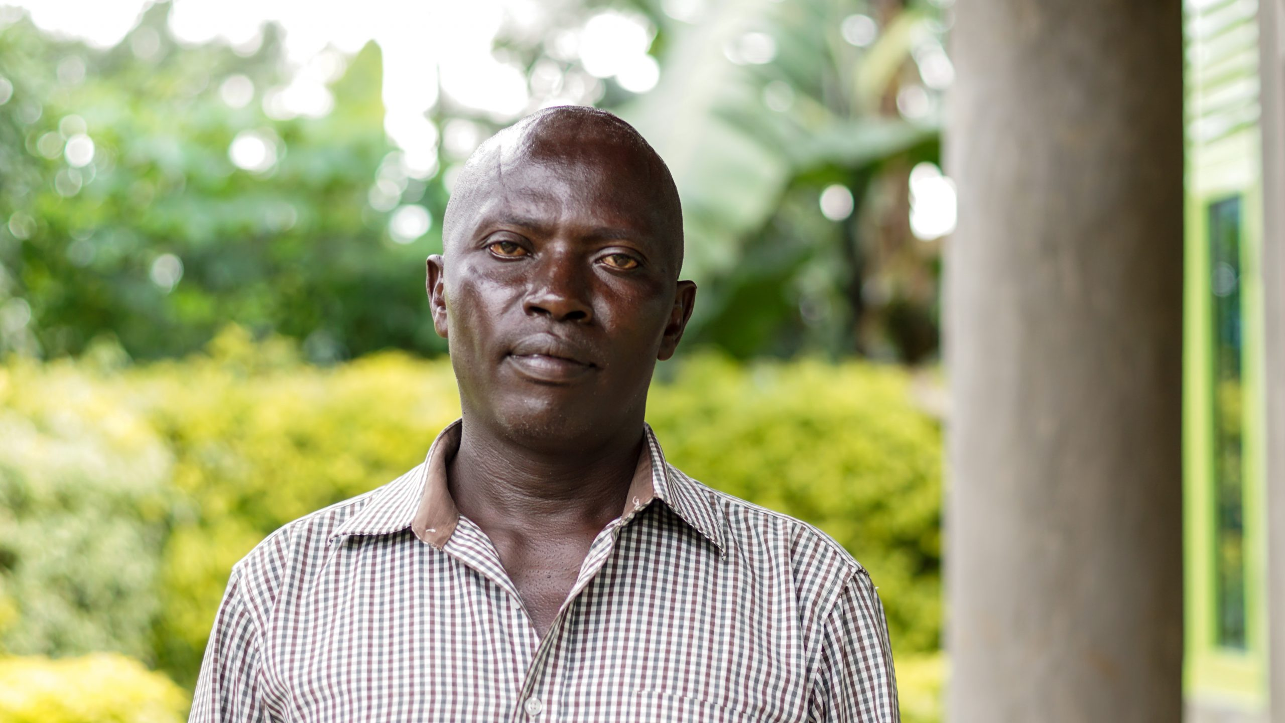 "Thousands of Tutsis, crammed in and around the Nyamasheke Parish Catholic Church, fought for their lives for a week. Stanislus Kayitera, now 53, was one of the few survivors. His forearm bears a large and irregular scar from grenade shrapnel. ""I remember women collecting stones and giving them to the men, who were throwing them at us. Men were also shooting, throwing grenades and pouring fuel over people and then setting them on fire. ""Then, they stormed the church and started to kill us with clubs,"" says Mr Kayitera, who survived by hiding under the dead bodies."
