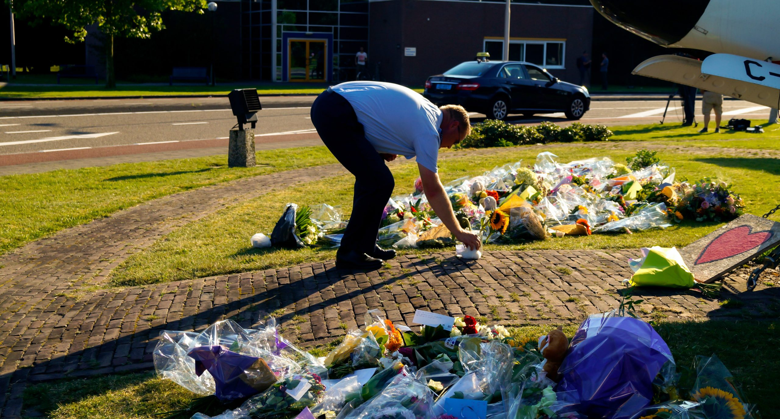 July 23, 2014: Eindhoven, Military Airport. Police officer is leaving flowers on behalf of the relatives of the victims.