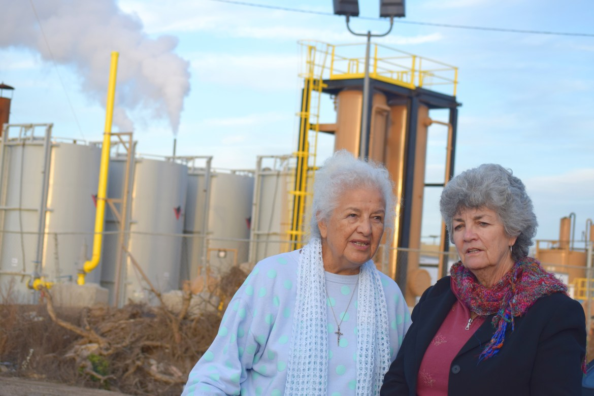 Activist Lupe Anguiano, left, and Councilwoman Carmen Ramirez stand near tanks of steam. (Photo by Elaine Fragosa)