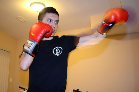 BRADFORD, ON – JANUARY 28 – Salvatore Severino practices kickboxing in his basement. This room is dedicated to fitness which is why he likes to practice here. While he continuously threw punches his mouth made a whistling sound that he says allows for more air flow. He says more air flow makes his punches better.