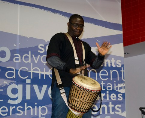 TORONTO, ON – FEBRUARY 26 – Master drummer, Babarinde (Baba) Williams plays his African drum while attenders of the event follow along. Happening in the student centre at Humber College, the first 50 students were eligible to play their own drum. This event was part of Black History Month. It was meant to be a commemoration to Madiba.