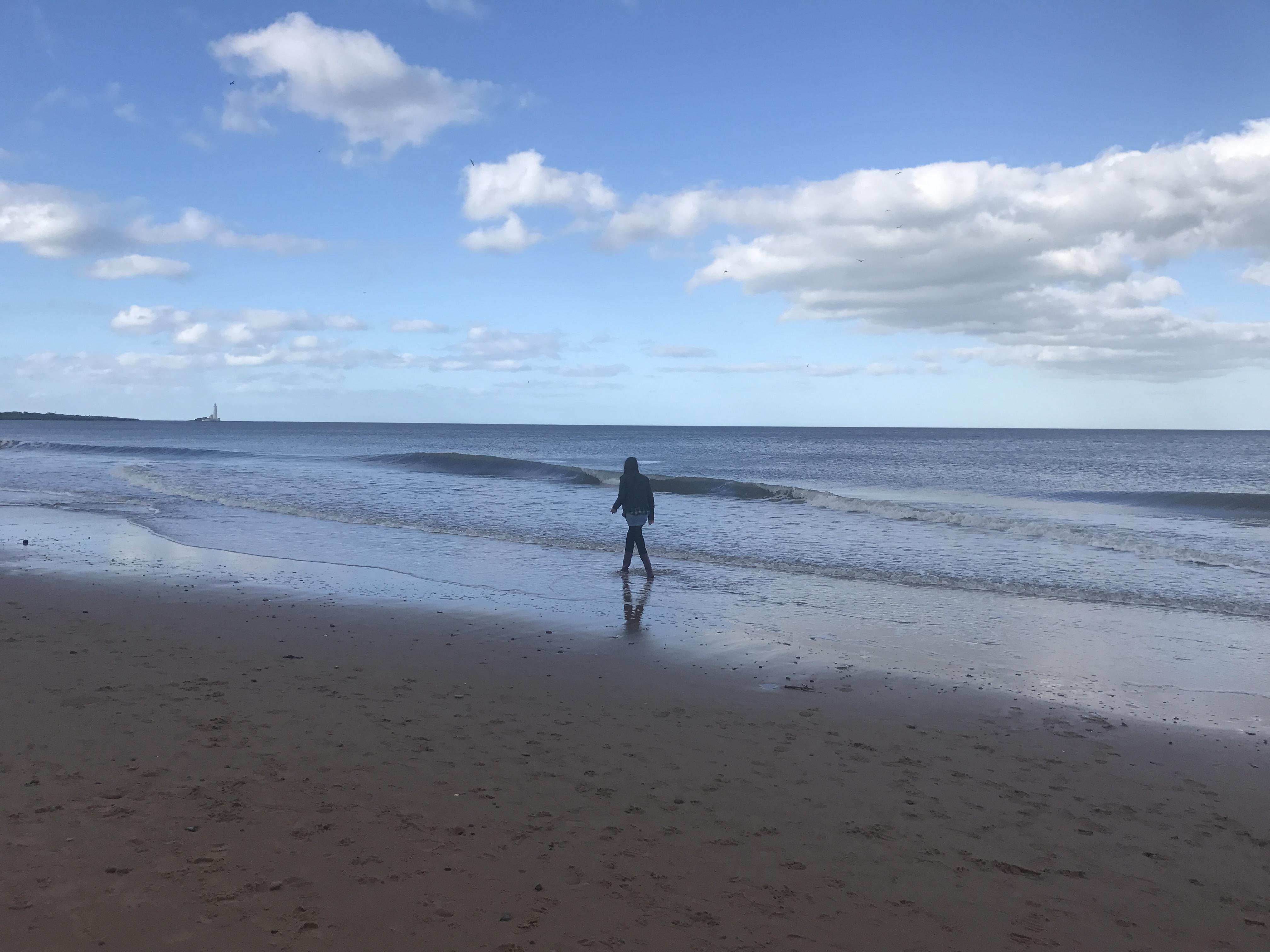 Walking down Whitley Bay beach