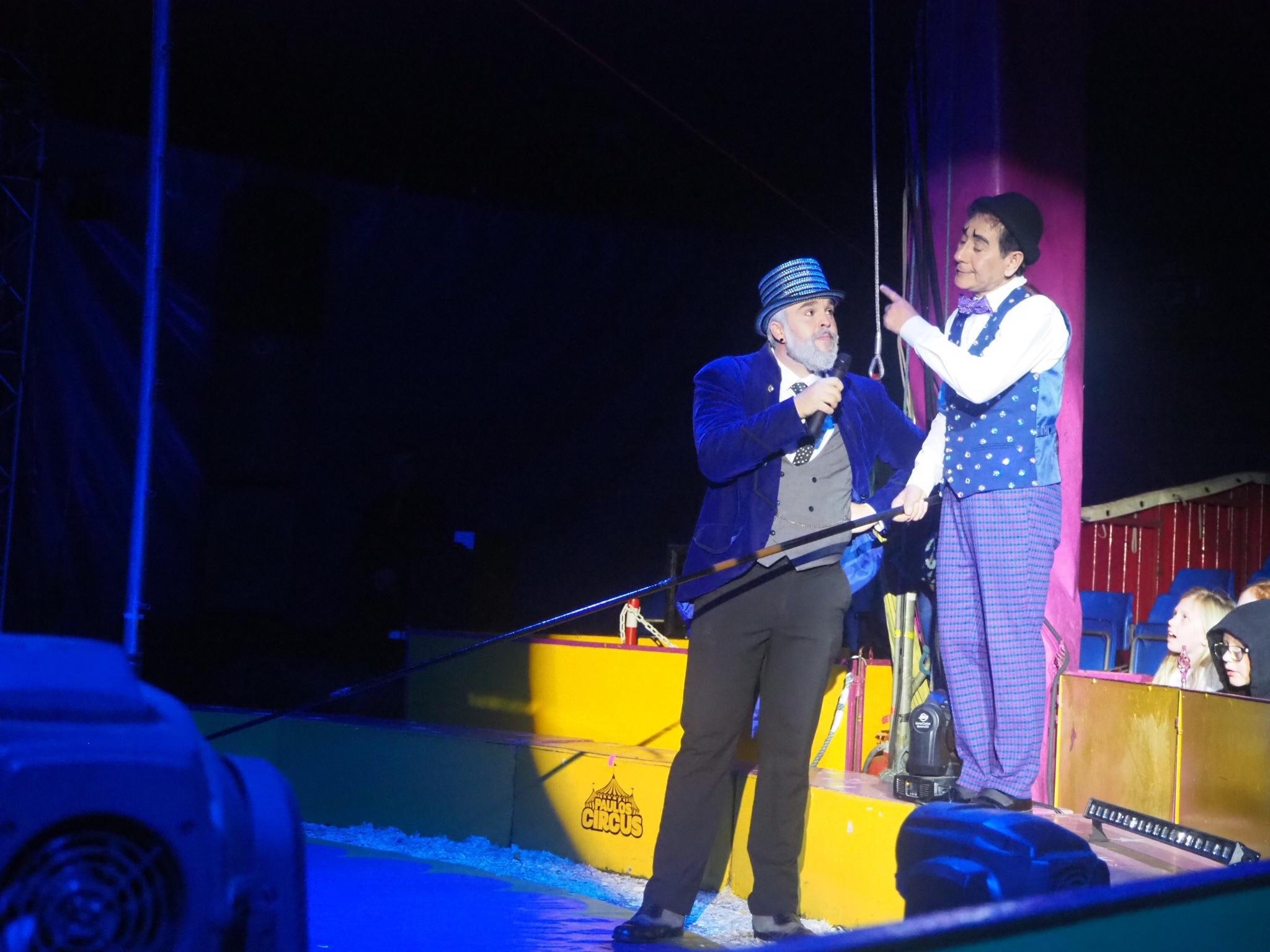 ringmaster and circus clown