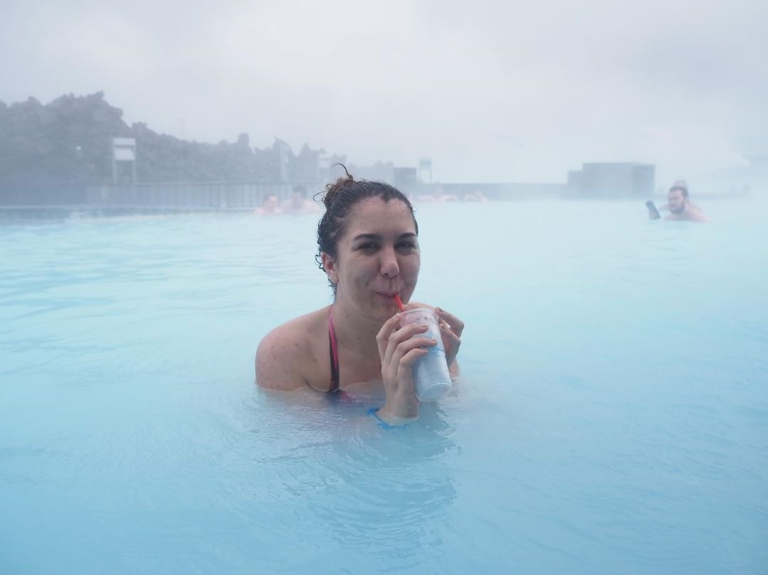 drinking a drink in the middle of the blue lagoon
