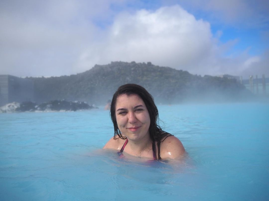 smiling to the camera in the blue lagoon