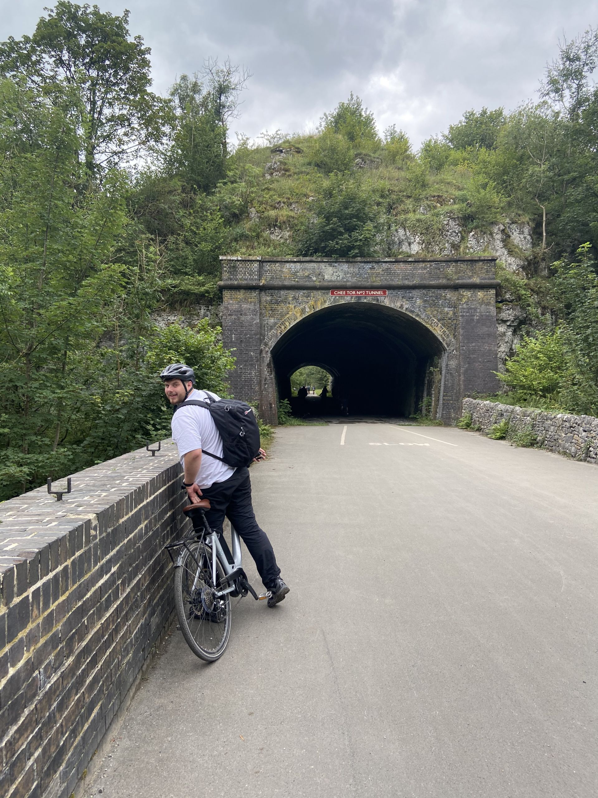 cycling the Monsal trail with one of the tunnels in the background