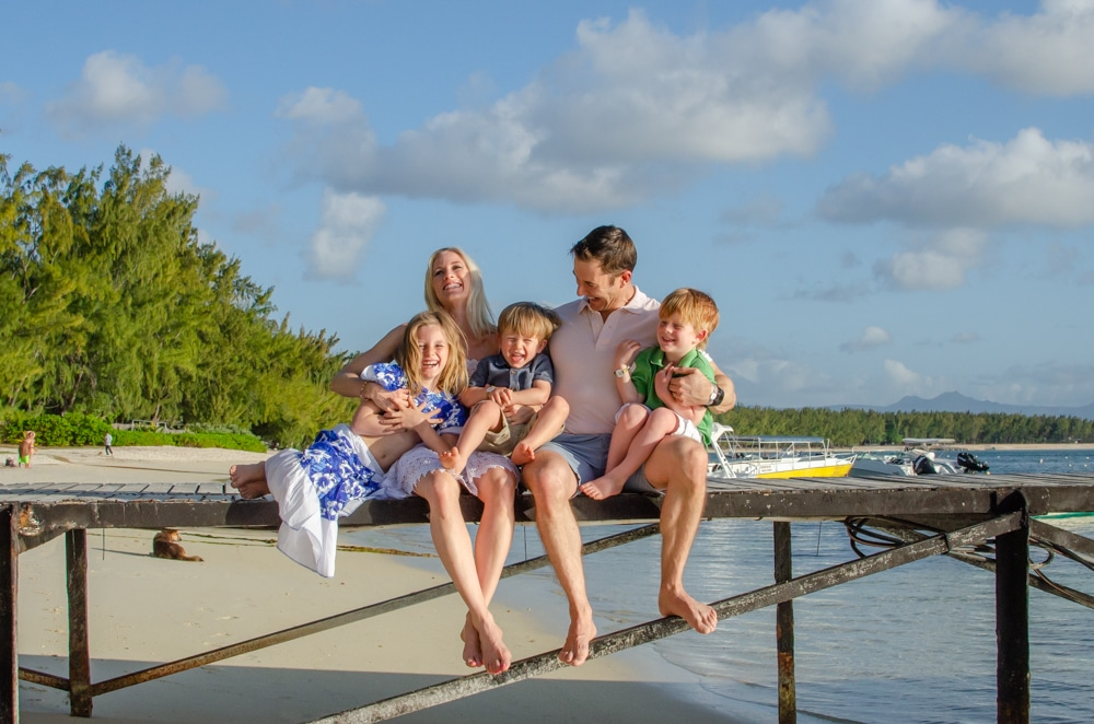 family posing on the pier for a photo shoot
