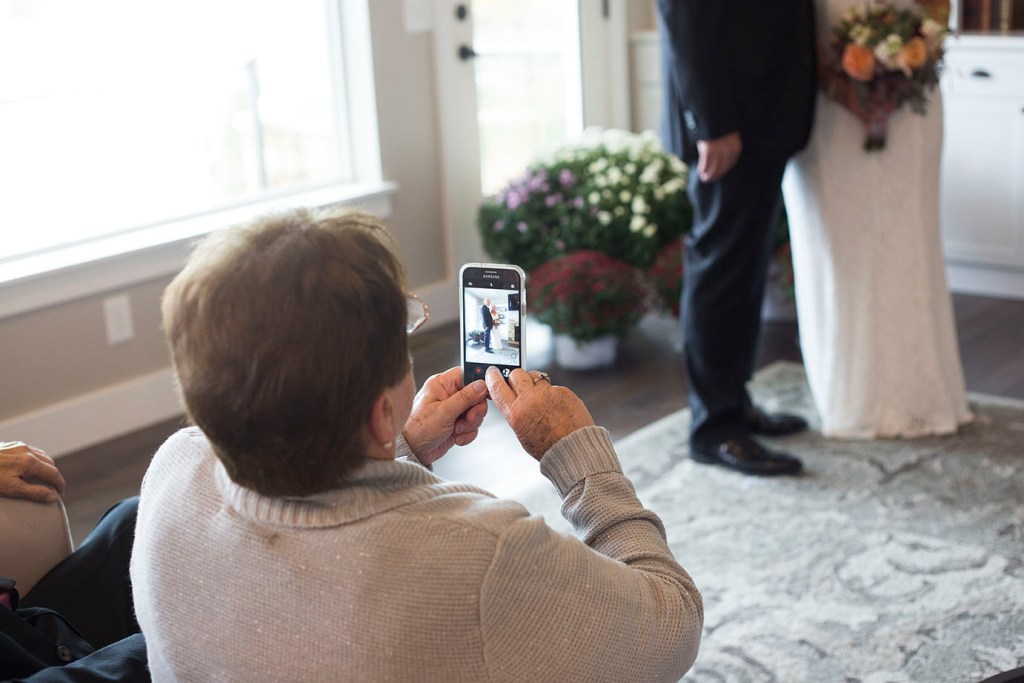 Mom takes photo of her daughter during their wedding