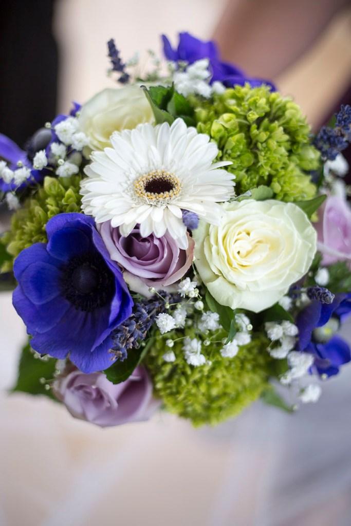 Purple, green, and white wedding bouquet at Detroit wedding